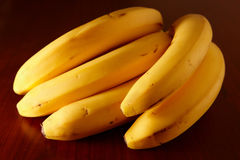 Bananas. Bunch of bananas on the wooden table. Nice side lighting Royalty Free Stock Photography