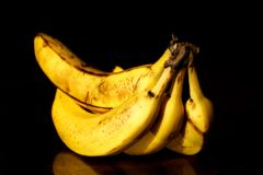 Bananas. A bunch of ripe bananas - isolated on black background Stock Image