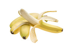 Bananas. A branch of three bananas and one peeled banana Royalty Free Stock Photography