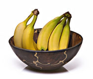 Bananas in an African Bowl. A Bunch of Bananas in an African Bowl Stock Images