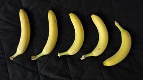 Bananas amarelas das bananas background Fotografia de Stock