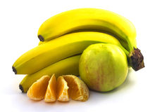 Bananas, apple and orange. Bananas, green apple and orange on white background Royalty Free Stock Images