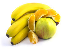 Bananas, apple and orange. Bananas, green apple and orange on white background Stock Image