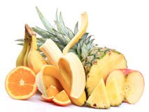 Bananas, apples, oranges, pineapple Stock Photos