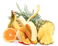 Bananas, apples, oranges, pineapple. On white background stock photography