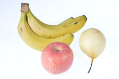 Bananas, apples, pears. Under the white background bananas, apples, pears Royalty Free Stock Photography