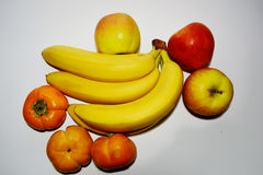 Bananas with apples and persimmons Royalty Free Stock Photography