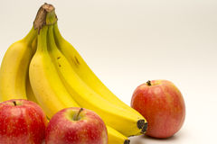 Bananas and apples  on white Royalty Free Stock Photography