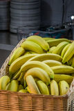 Bananas in a basket Stock Images