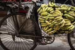 Bananas on a bike on a street. Market Stock Photography
