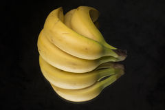 Bananas on a black tanle Royalty Free Stock Photography
