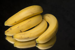 Bananas on a black tanle Stock Photo