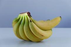 Bananas on bluish background Stock Photo