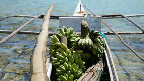 Bananas in the boat. Boat transporting bananas.fruits in the boat ,floating market.Bananas in the national Philippine boat.Asian market stock footage