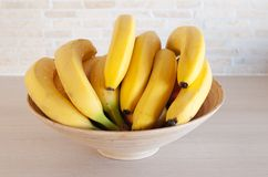 Bananas in a bowl. Bananas in a wooden bowl Stock Photos