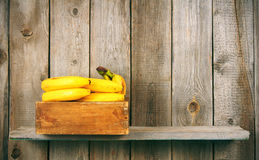 Bananas in a box Stock Photography