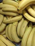 Bananas in a box. Yellow bananas in a box royalty free stock photos