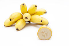 Bananas. A bunch of bananas and its flesh on a white background royalty free stock images