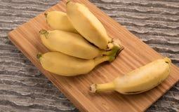 Bananas bunch and a single babana Stock Images