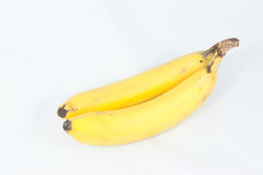 Bananas bunch with soft shadow on white background. A closeup of fresh yellow bananas isolated on a white background Stock Photo