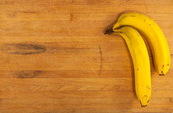 Bananas on Butcher Block Royalty Free Stock Photos