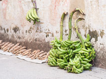 Bananas and cassavas sold on Zanzibar. Local bananas and cassavas sold on one of the street of Stone Town, Zanzibar, East Africa Royalty Free Stock Image