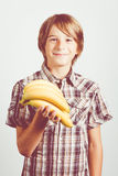 Bananas child. Child with bananas in the hands Royalty Free Stock Photography