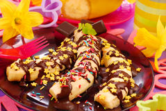 Bananas with chocolate and sprinkles for child Stock Photos