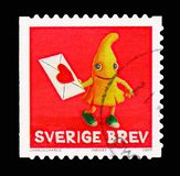 Bananas, Clay Figures serie, circa 2009. MOSCOW, RUSSIA - AUGUST 18, 2018: A stamp printed in Sweden shows Bananas, Clay Figures serie, circa 2009 royalty free stock photos