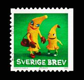 Bananas, Clay Figures serie, circa 2009. MOSCOW, RUSSIA - AUGUST 18, 2018: A stamp printed in Sweden shows Bananas, Clay Figures serie, circa 2009 royalty free stock image