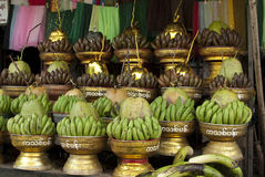 Bananas and Coconut Offering. Bananas and coconuts for temple offering, Yangon market, Burma Stock Image