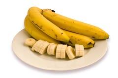 Bananas com fatias Fotografia de Stock Royalty Free