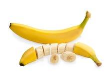 Bananas cortadas frescas isoladas no fundo branco Imagens de Stock Royalty Free