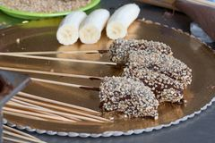 Bananas covered with chocolate and nuts royalty free stock image