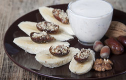 Bananas with dates , nuts . Royalty Free Stock Photos