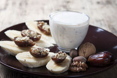 Bananas with dates , nuts  . Stock Photography