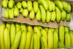 Bananas on display from market shelves real with flaws Royalty Free Stock Photography