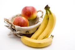 Bananas e maçã fotos de stock