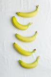 Bananas em uma fileira Imagens de Stock Royalty Free