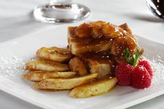 Bananas Foster bread pudding. A hybrid dish of Bananas Foster and bread pudding Stock Photos
