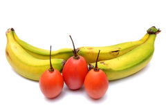 Bananas and French tomatoes. With white background royalty free stock photo
