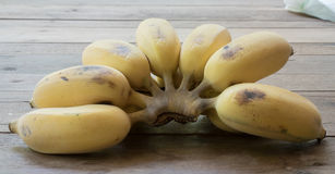 Bananas. Fresh bananas on a wooden table background Stock Image