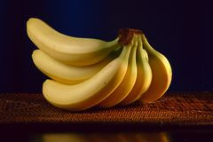Bananas in front of black background Royalty Free Stock Photos