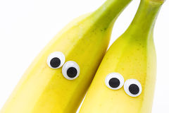 Bananas with googly eyes on white background. Banana face Stock Photography