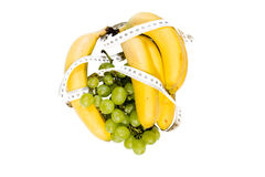 Bananas and grape with meter. Bananas and grape with meter on white background royalty free stock photos