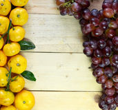 Bananas and grapes on the wooden floor. Fruits on the wooden floor Royalty Free Stock Image