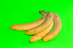Bananas on green background Stock Images