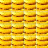 Bananas inside square shapes arranged as background. Background made of identical square shapes full of bananas royalty free stock image