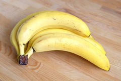 Bananas isolated on wooden background close-up Stock Image