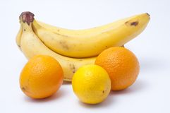 Bananas a lemon and two oranges Royalty Free Stock Photo